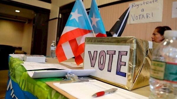 Puerto Ricans who fled the island for the U.S. mainland after Maria are eligible for the first time to vote in congressional elections. AP Photo/Julio Cortez
