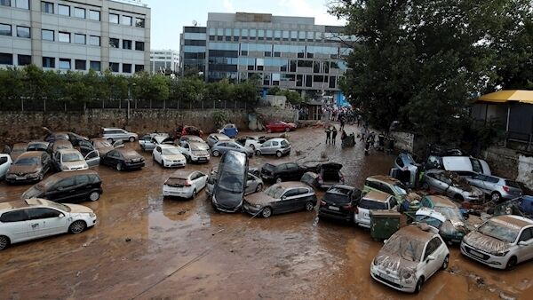 Damaged cars strewn across a parking area in Athens last July after flash floods caused by a sudden downpour. It came three days after a wildfire north-east of Athens killed at least 82 people and injured more than 180. Picture: Thanassis Stavrakis/AP