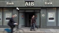 AIB tumbles as CEO heads to Davy
