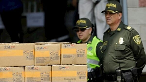 Boxes of humanitarian aid from the USAID agency piled up in Colombia, near its border with Venezuela. AP Photo/Fernando Vergara