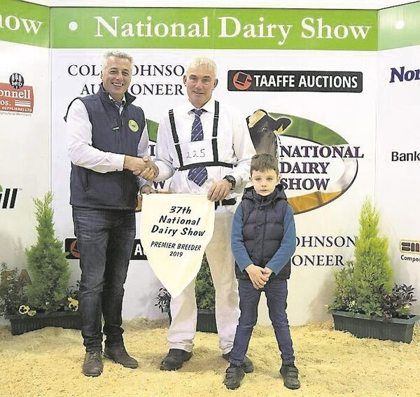 Rickey Barrett, Cork, and his son John receive the Premier Breeder Award from Sean O'Flynn, The Farm Store, sponsor, at the National Dairy Show. Picture: Maria Kelly