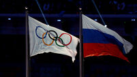 Russia and Olympic Flags File Photo