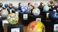 Whole world in their hands: Icons design globes in aid of GOAL