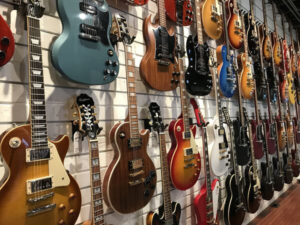 A selection of instruments at the Wall Grace Vintage cars and guitars store in Wynwood, Miami (Ryan Hooper/PA)