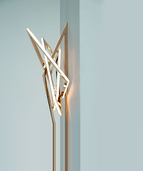Gesture II is a mirror polished, hand-formed solid bronze light sculpture, with opal glass mosaic and LEDs.