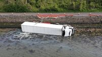 Driver arrested in Cork after truck crashes into sea