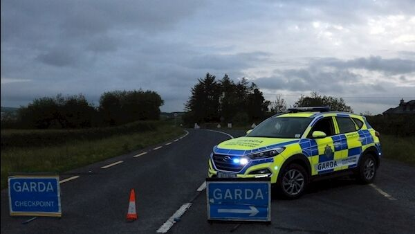 Gardaí at the scene of the collision in Loughill yesterday evening. Photo: Brendan Gleeson.