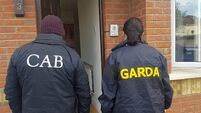 Gardaí investigating money laundering raid four premises and freeze €40k in bank account