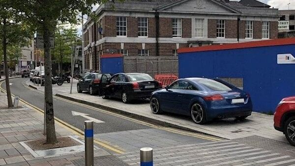 Cars parked on the footpath near the Coal Quay in Corl.