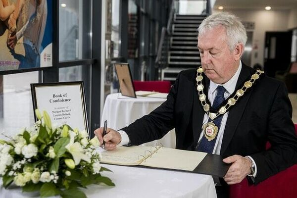 Councillor Sean McPeake, chairman of Mid-Ulster District Council, signing a book of condolence in Cookstown (Liam McBurney/PA)