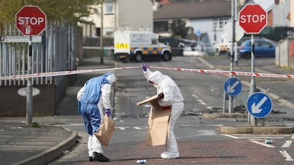 Police forensic officers at the scene in Derry, today.