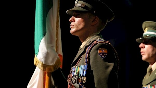 Lt. Matthew Kennedy, 12th Batallion, Limerick holds the Irish flag