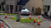 Children have lucky escape as car reverses past them and into side of house in Clare