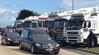 Family 'speechless' as hundreds of truck drivers form guard of honour at colleague's funeral