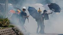 Hong Kong police fire tear gas in clash with protestors
