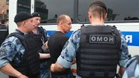 Russian police arrest demonstrators at protest against police abuse