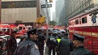 At least one dead as helicopter crashes into building in midtown Manhattan