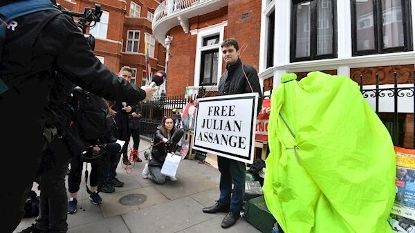 Kyle Farren with a 'Free Julian Assange' banner outside the Ecuadorian embassy today.