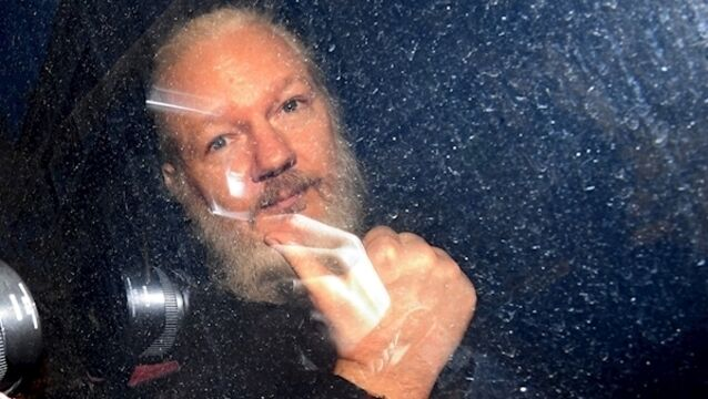 Julian Assange arrives at Westminster Magistrates' Court following further arrest 'on behalf of US'