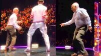 Hugh Jackman throws the best of shapes with the Irish Tom Jones during Dublin gig