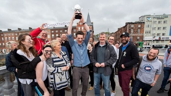 Mark Lonergan, Victorian Quarter holding the trophy aloft after his side defeated the Douglas Street traders. Picture: Dan Linehan