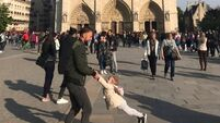 Search for 'father and daughter' in heart-warming photo taken minutes before Notre Dame fire
