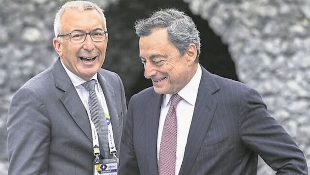 Draghi's talk of stimulus weakens euro, boosts shares