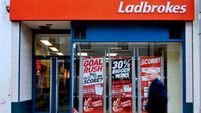 Ladbrokes owner shares fall even as online offsets UK hit