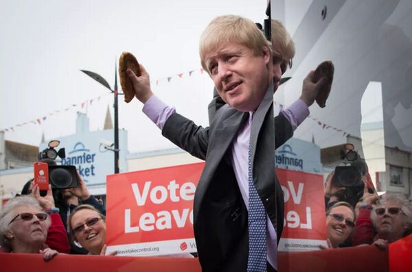 Boris Johnson waves a Cornish pasty from his Brexit bus on the campaign trail in 2016. No one can remember if we found it funny at the time. PA.
