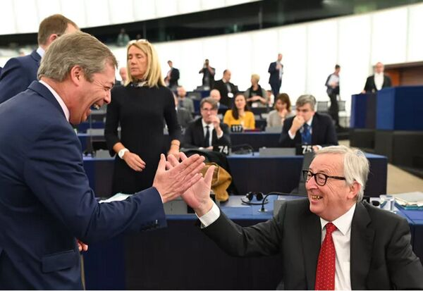 Nigel Farage has a laugh with Jean Claude Juncker, while the UK burns. EPA/Patrick Seeger.