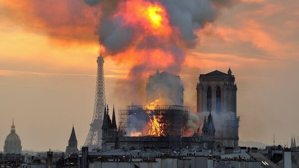 Notre Dame cathedral ablaze in Paris on Monday. The 12-hour fire destroyed its spire and its roof, but not its twin medieval bell towers. The Crown of Thorns purportedly worn by Jesus was rescued. Picture: AP /Thierry Mallet