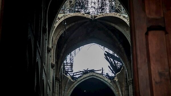 A hole in the dome inside Notre Dame cathedral in Paris. Picture: Christophe Petit Tesson, Pool via AP
