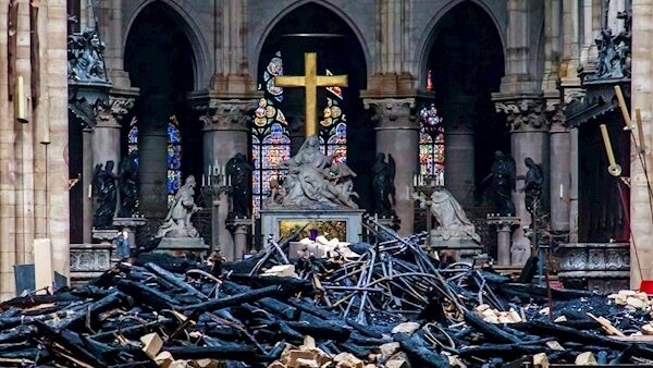 Debris inside Notre Dame cathedral in Paris after the blaze was quenched. Picture: Christophe Petit Tesson, Pool via AP