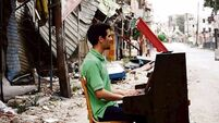 Portrait of a piano man of Yarmouk