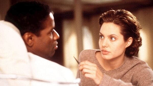 Denzel Washington and Angelina Jolie in The Bone Collector, adapted from Deaver's book.