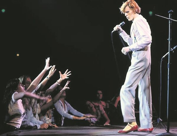 David Bowie in concert during his Diamond Dog tour in Los Angeles, circa 1974. Picture: Terry O'Neill