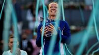 Bertens brushes aside Halep to win Madrid Open