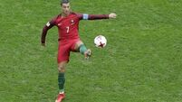 Ronaldo forced off injured as Portugal held by Serbia