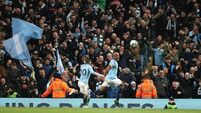 Vincent Kompany screamer sends Man City back to the top