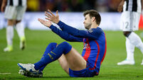 Barca defender Pique simply minding his own business