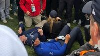 Henrik Stenson poses for selfie with fan after hitting him with ball