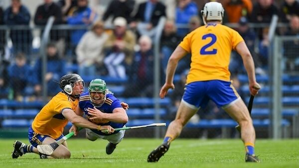 Tipperary's John O'Dwyer and Clare's David McInerney tumble during yesterday's Munster SHC clash at Cusack Park. Picture: Piaras Ó Mídheach