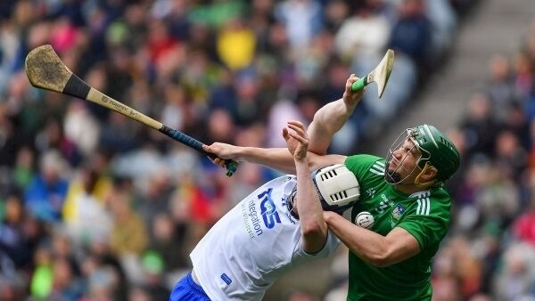 Seán Finn of Limerick in action against Stephen Bennett of Waterford