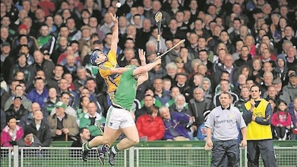 Clare's Conor Cooney soars for possession watched by Davy Fitzgerald and Paul Kinnerk. Picture: Diarmuid Greene