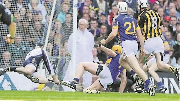 Kilkenny's Michael Fennelly charges through the Tipp defence to fire a goal past Brendan Cummins. Picture: Brian Lawless