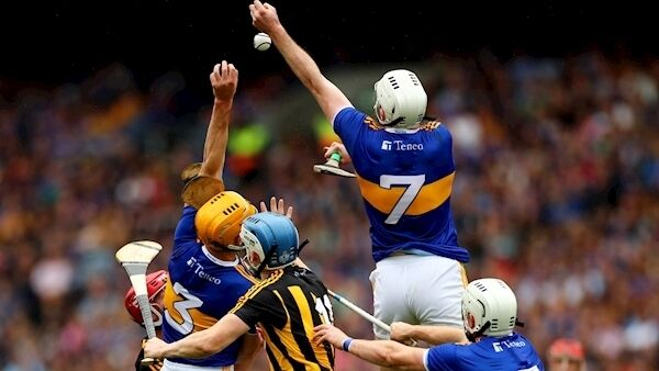 Tipperary's Séamus Kennedy climbs highest for this play. Pictures: INPHO/James Crombie