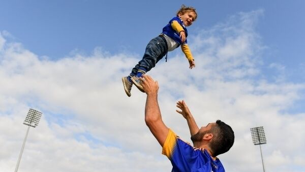Graham O'Riordan with his son Isaac O'Riordan, age 2, from Roscrea, Co Tipperary at the Tipperary All-Ireland homecoming event at Semple Stadium in Thurles yesterday. Picture: Sam Barnes/Sportsfile