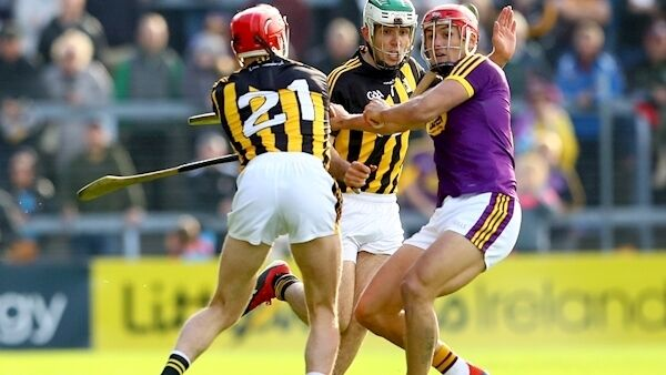 Kilkenny's Cillian Buckley and Paddy Deegan with Lee Chin of Wexford. Picture: INPHO/James Crombie