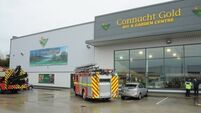 Customer killed, man fighting for life, three seriously hurt in Longford wall collapse