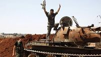 Syrian rebels in 'desperate' need of guns, chief says